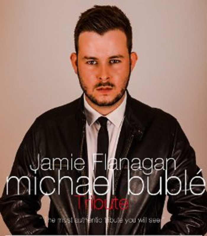 Jmaie Flanagan as Michael Buble with his big band